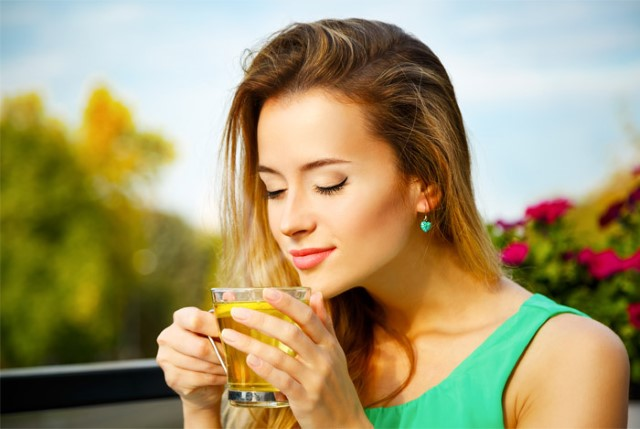 1-woman-enjoying-green-tea (Custom)