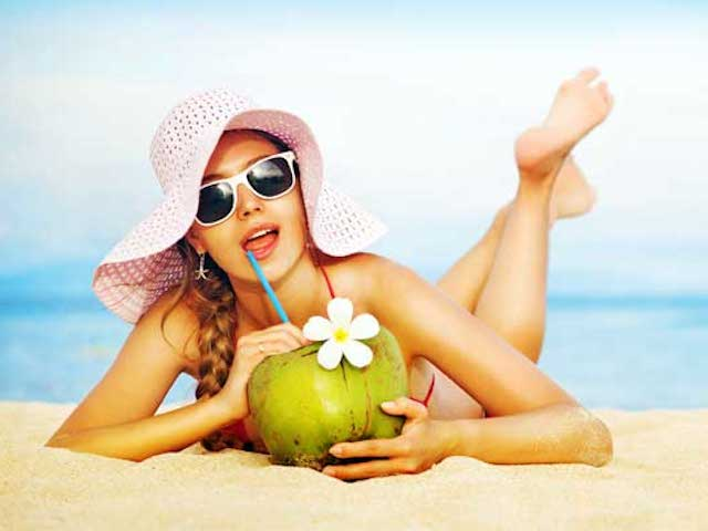 2-woman-beach-drinking-coconut