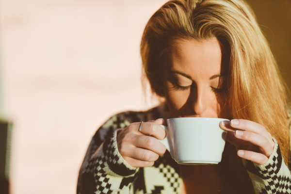 Blond-Girl-Peacefully-Drinking-Coffee-At-Sunrise_ (Custom)
