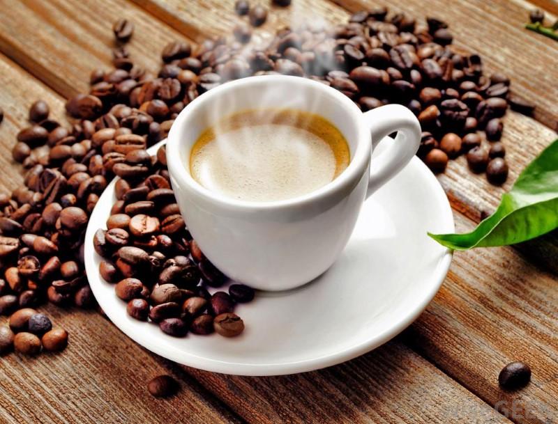 hot-coffee-in-white-mug-on-white-plate-near-beans (Custom)